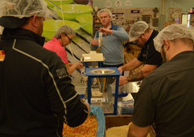 Crawford Roofing Employees volunteering with Feed My Starving Children Through Rabine Group Foundation